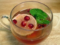 A cup of pomegranate champagne punch