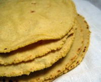 A stack of homemade corn tortillas