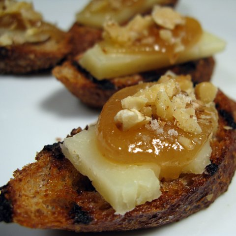 Manchego, Quince, and Walnut Crostini