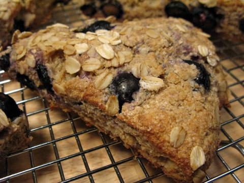 Whole wheat blueberry-oat scones cooling on a rack